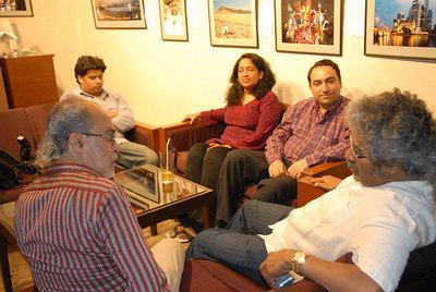 Hari Haran talking with Swapan, Anu, Suchit and Hari Haran's son.