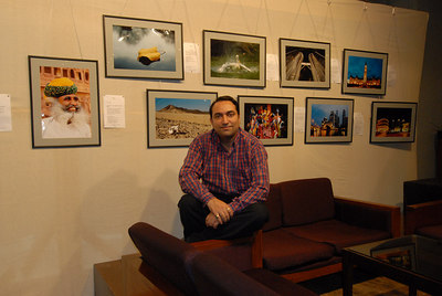 Suchit Nanda in front of his pictures exhibited at the Rodas Hotel, Powai, Mumbai.