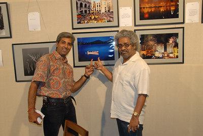 Hari Haran with Mukesh Trivedi admiring his pictures.
