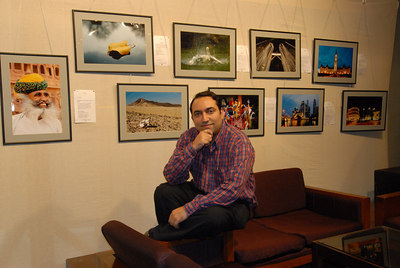 Suchit with his pictures behind him.