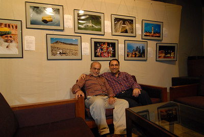 Swapan and Suchit in front of Suchit's pictures at Rodas Hotel, Powai.