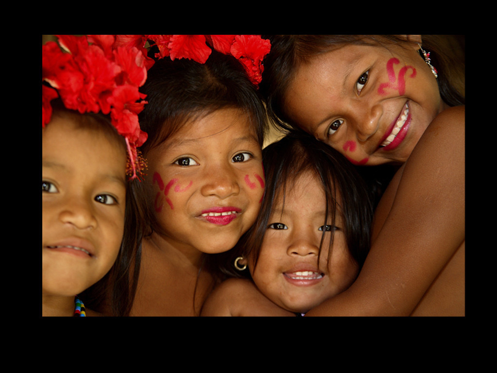 Panama: Only kilometers from intense fighting in Colombia and across the border in Panama, children of this Emberá community proudly show off their traditional body painting and jewelry.