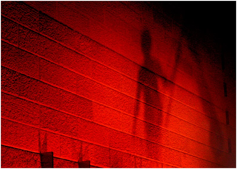 Photo Friday Challenge: Red. <br /> 10th March 2006<br /> <br /> The shadow of an Aboriginal dancer is cast on a sandstone wall during a performance by dance group Eora Crossing.