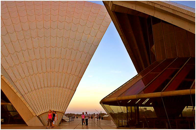 Photo Friday Challenge: Golden. <br /> 21st April 2006.<br /> <br /> The white sails of the Opera House glow a golden colour with the setting sun.
