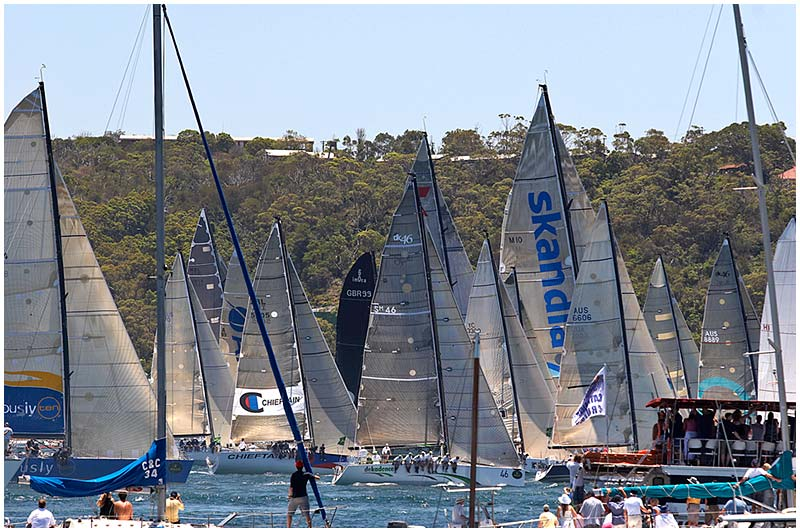 Photo Friday Challenge: Full. <br /> 14th April 2006.<br /> <br /> Spectators cheer on the yachts at the start of the annual Sydney to Hobart yacht race. This international classic event covers 630 nautical miles of ocean racing in often difficult seas.