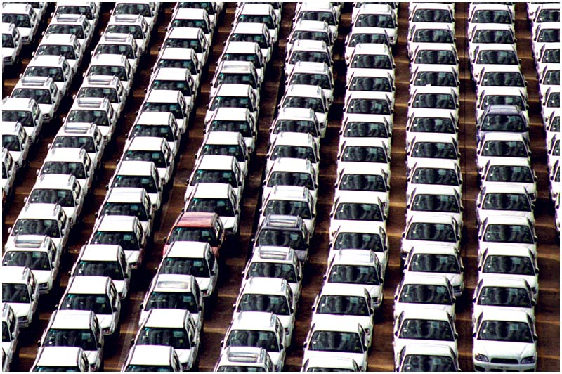 Photo Friday Challenge: Organized. <br /> 7th April 2006<br /> <br /> Imported cars waiting to be transported to dealerships around the country.