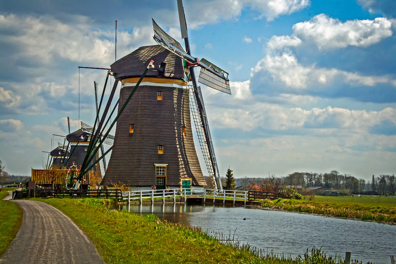 Biking by windmill residences.