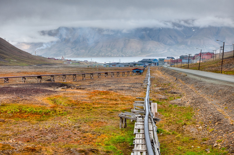 Longyearbyen is a town of less than 2000 people. The utility pipes are above ground because of the permafrost.