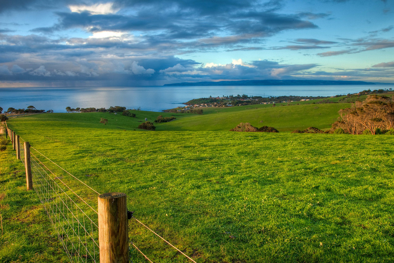 Looking upon Penneshaw (Kangaroo Island) and the rain clouds near the mainland of Australia
