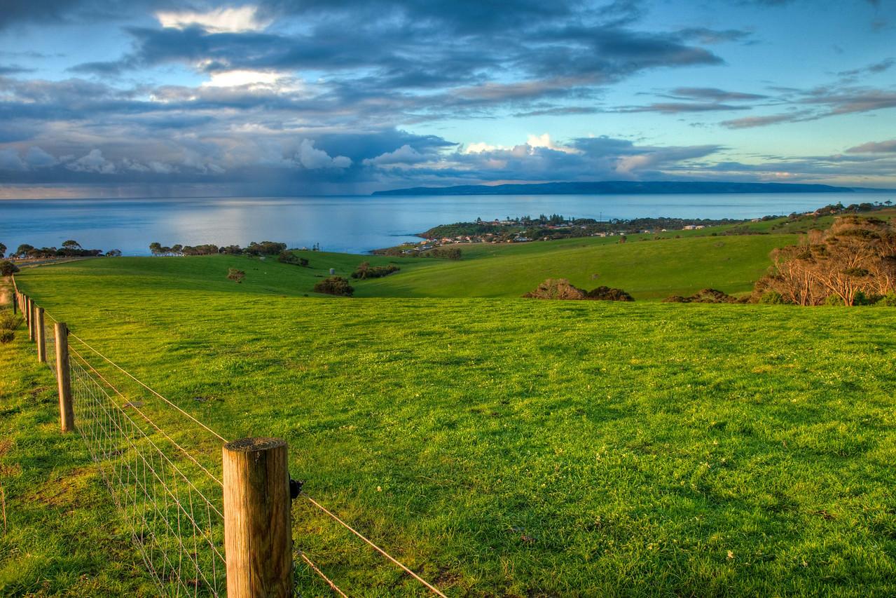 Looking upon Penneshaw (Kangaroo Island) and the rain clouds near the mainland of Australia