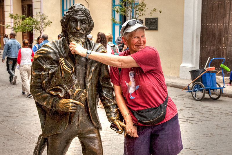 This is the Monument of the Street Person. Stroke his beard and pull his finger while making a wish and it will come true. What did you wish Julie?