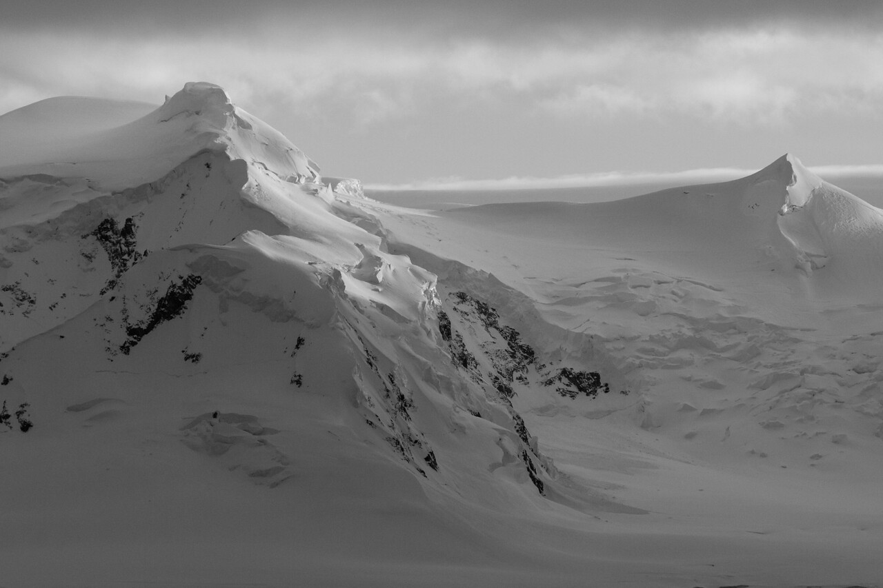 The landscapes were spectacular. Here in black and white you see massive mountains made delicate by the snow.
