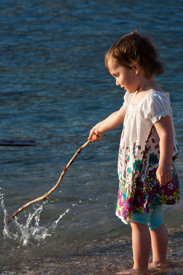 Playing at waterside, Korcula, Croatia