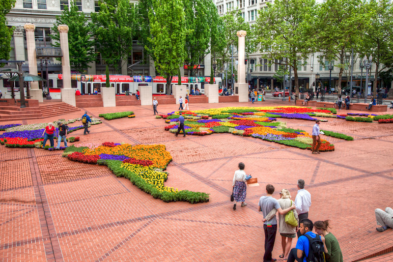 World map made from potted flowers, downtown Portland