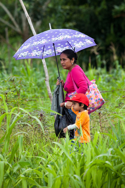 This mother and her son walking along a trail under the protection of a colorful parasol caught my attention. Looking quite contemporary, they seemed so out of context to the surroundings.
