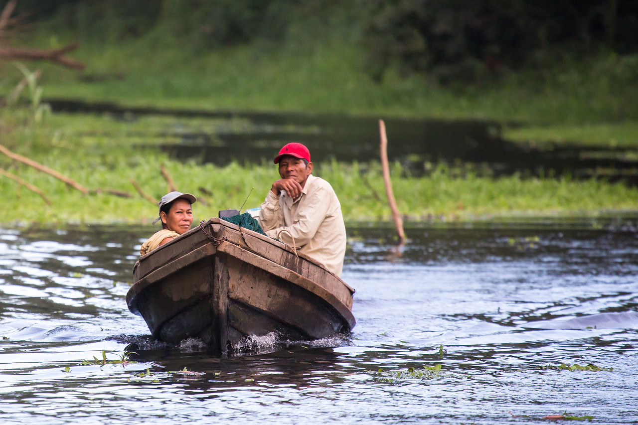 Fisher man and woman traveling in the backwaters.