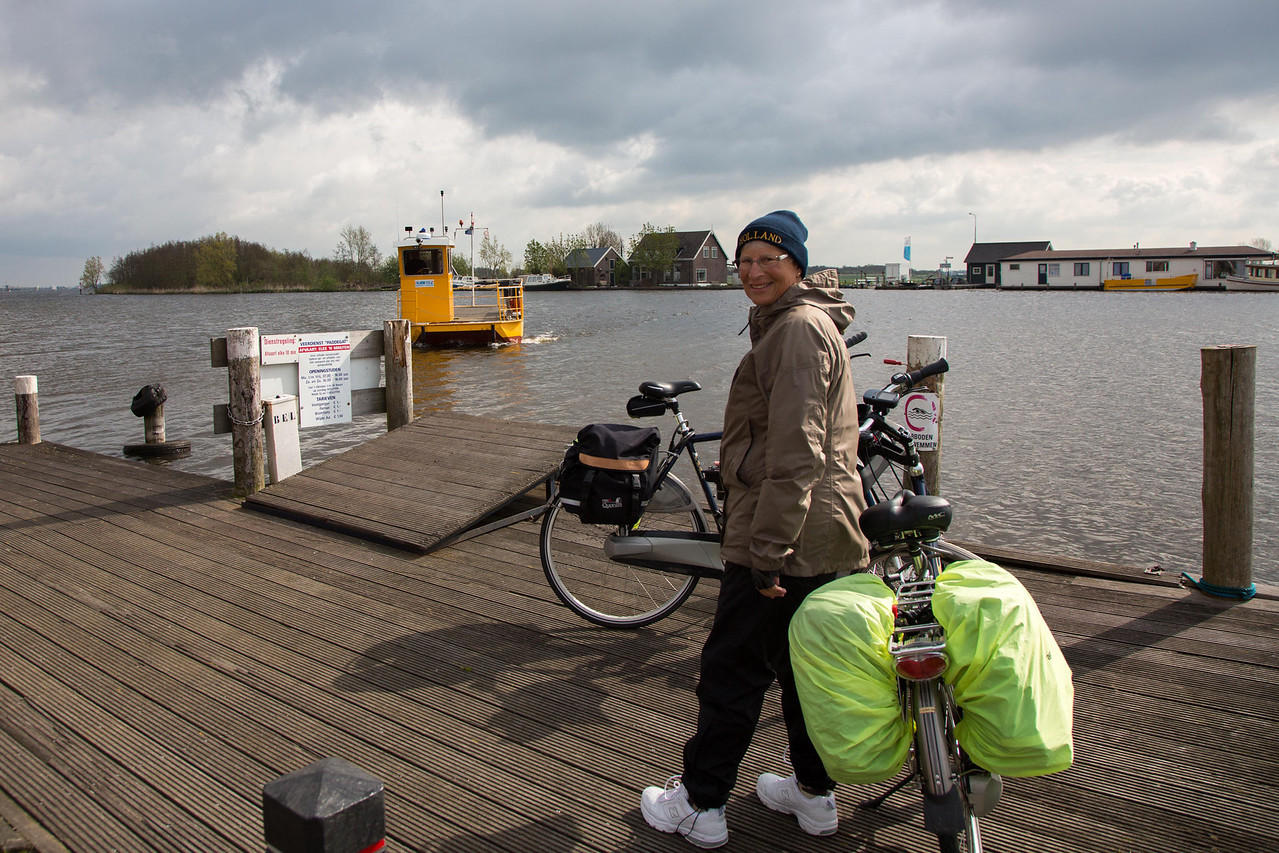 We're biking along one day and suddenly come to this spot. Julie's GPS and my map show we cross over the canal, but there is no bridge. Suddenly from across the river this small ferry appears to transport us to the other side.