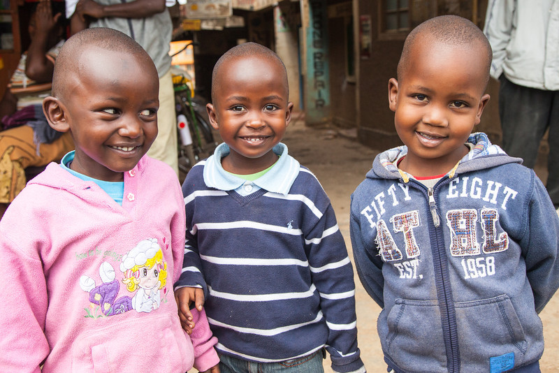 We stopped to buy corn to fill our bean bags which we use to lay our cameras on when photographing from the Landrovers. These three young Kenyans were curious about us and I loved their smiles.