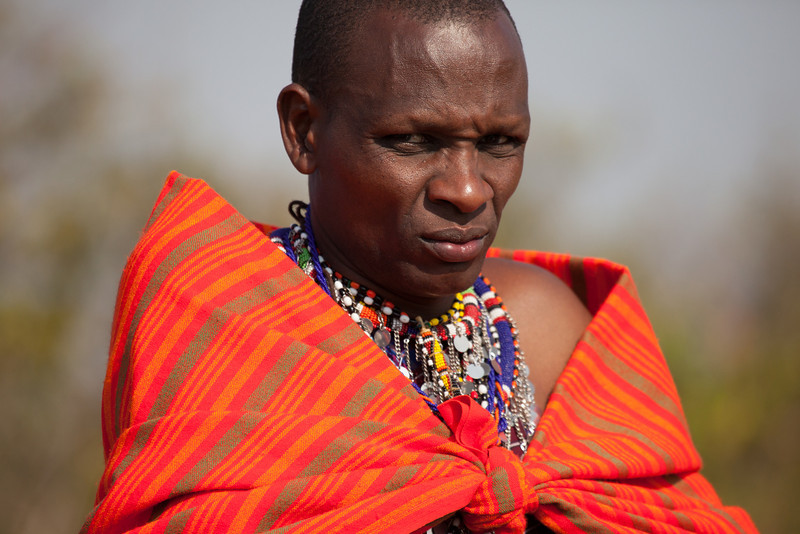 A proud member of the Masai looking askance at the camera.