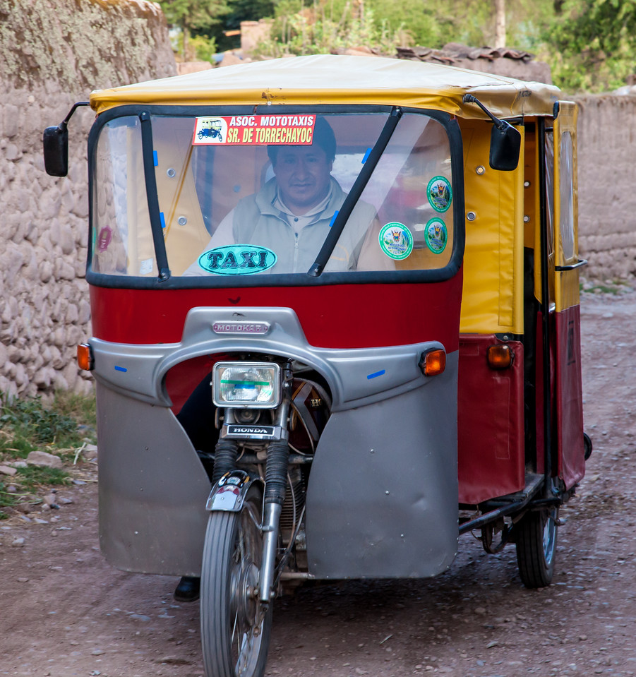 These mototaxis were everywhere in the towns we visited.  They are like a motorcycle trike with the driver in the front and room for two passengers sitting comfortably in the back, but we often saw more crowded in.