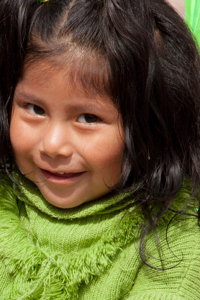 A young girl outside the Cusco marketplace.