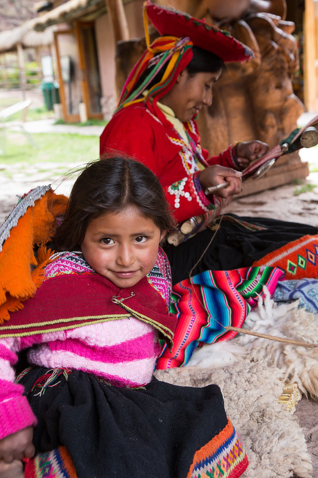 At the farm were people demonstrating weaving and then selling their products. This pretty young girl was assisting her mother.