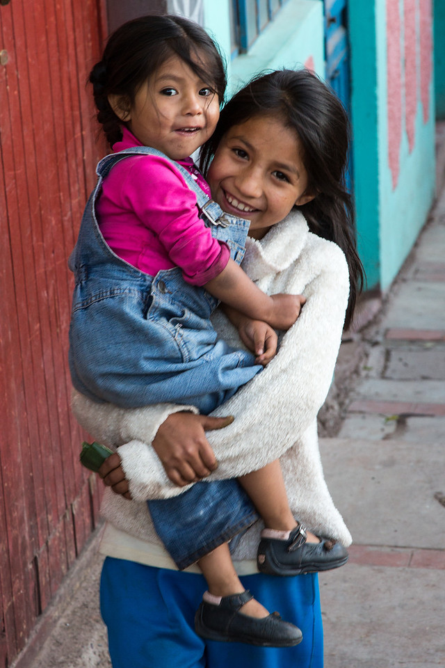 A young girl and her younger sister happily greeted us