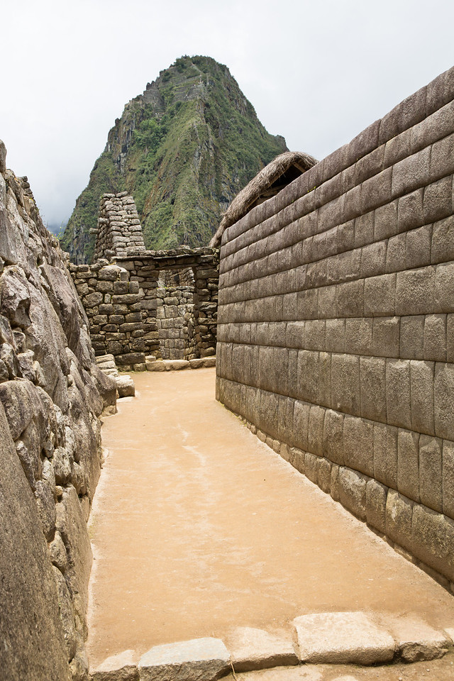 The stones to build the walls were excavated and hauled up the mountain. The stones on the right were ground by other stones to perfectly straight edges and exact dimensions so they fit without the need for mortar. And those walls still stand 500 years later.