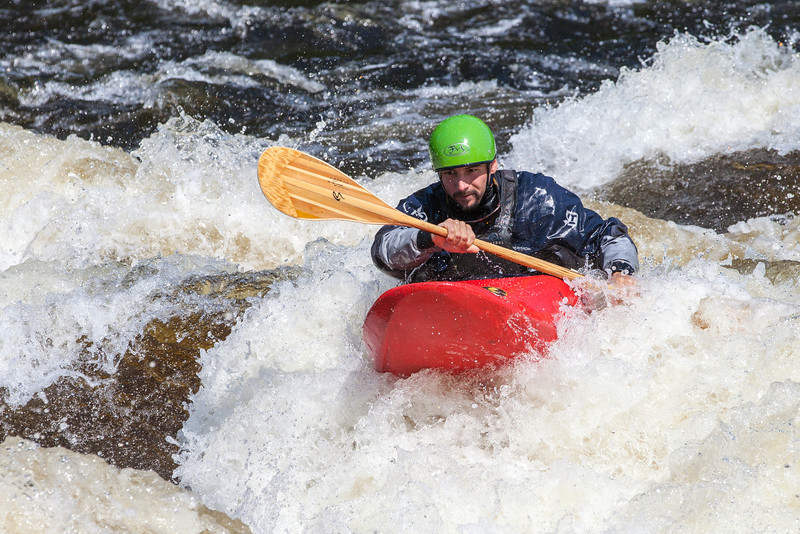 Kayaker intensely negotiating the rapids of the Penobscot