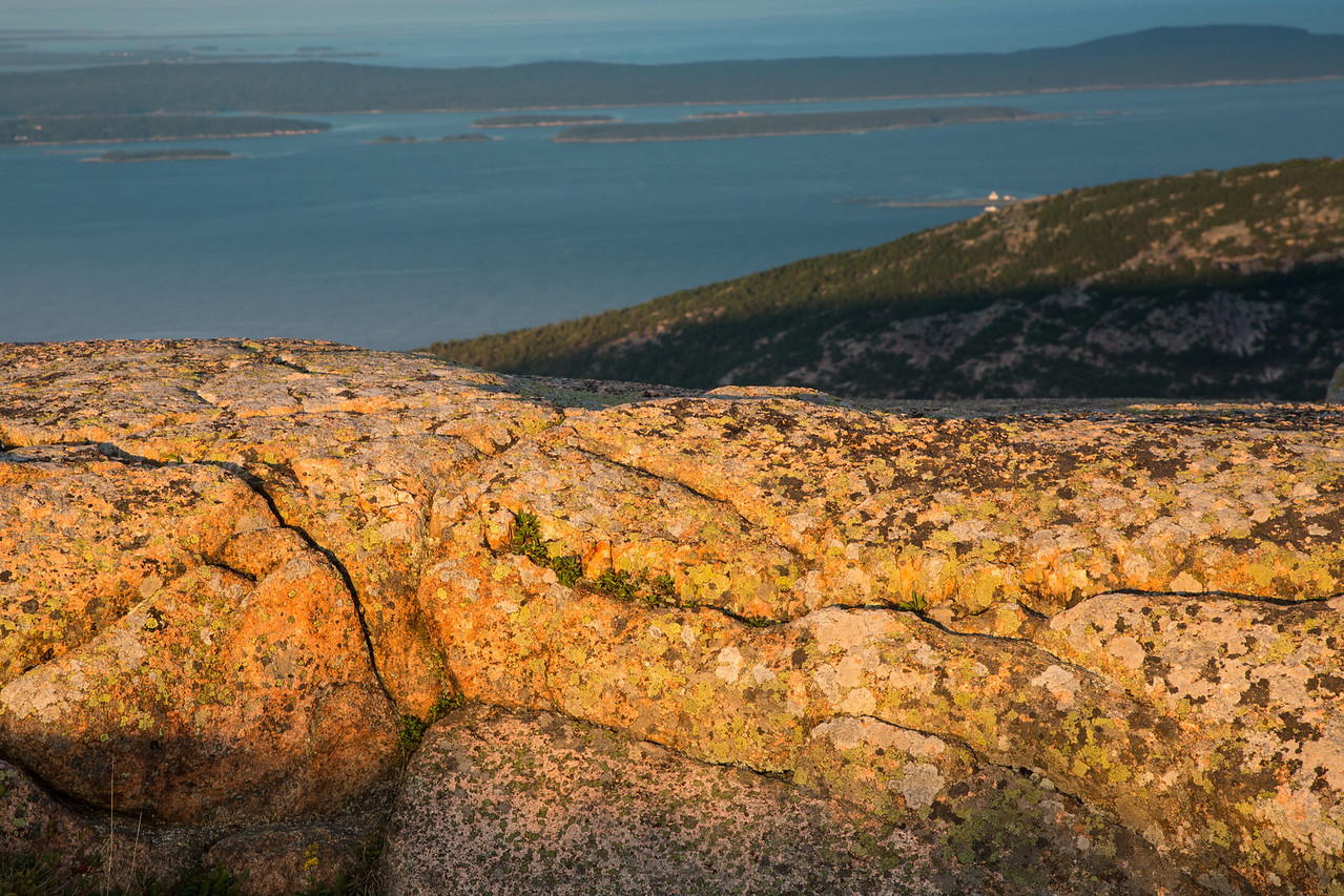 And the closing photo of the setting sun giving a golden glow to the pink granite on top of Cadillac Mountain with a view of Frenchman Bay in the background