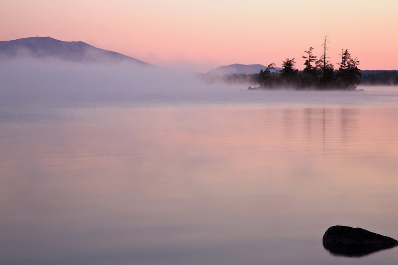 A view of early morning fog across Five Lakes with Mt. Katahdin in the background