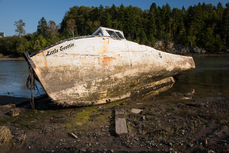 A fishing boat that has seen better days at Campobello Park, Canada, during low tide.
