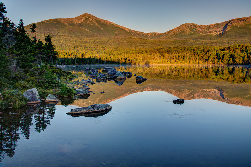 "We awoke at 4:30 am, drove an hour to Baxter State Park, hiked a mile into Sandy Stream Lake in the dark in hopes of seeing moose feeding at dawn. ""Moose are always at Sandy Stream Lake"" we were told. We sat for three hours on the rocks waiting but no moose. Yet looking at Mt. Katahdin and its reflection in the lake was a worthwhile reward."