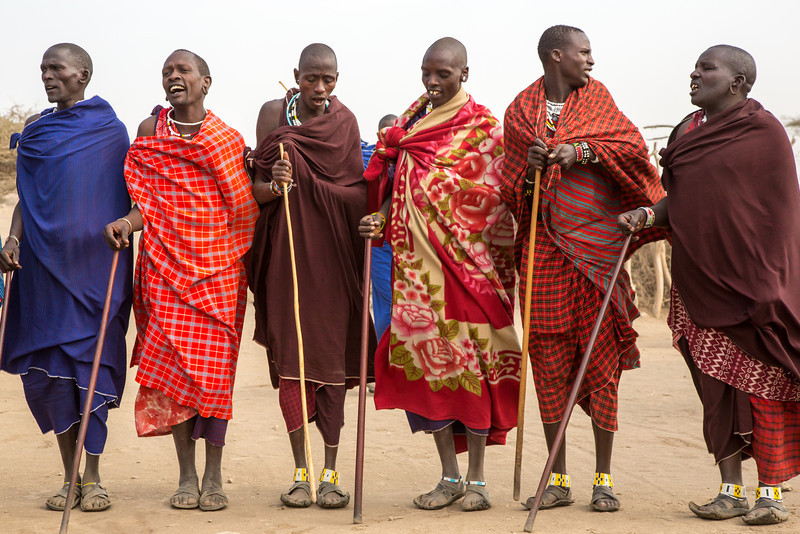 The men prepare for a tribal dance. The Masai people are struggling with the forces of change, beckoning some to adopt more modern lifestyles while others seek to preserve the strong traditions of the past.