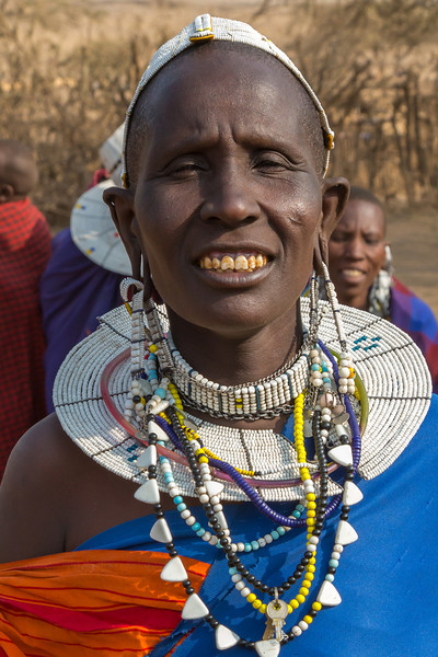An elder woman displaying her jewelry. Note the conventional key on one necklace. I wonder what it unlocks!