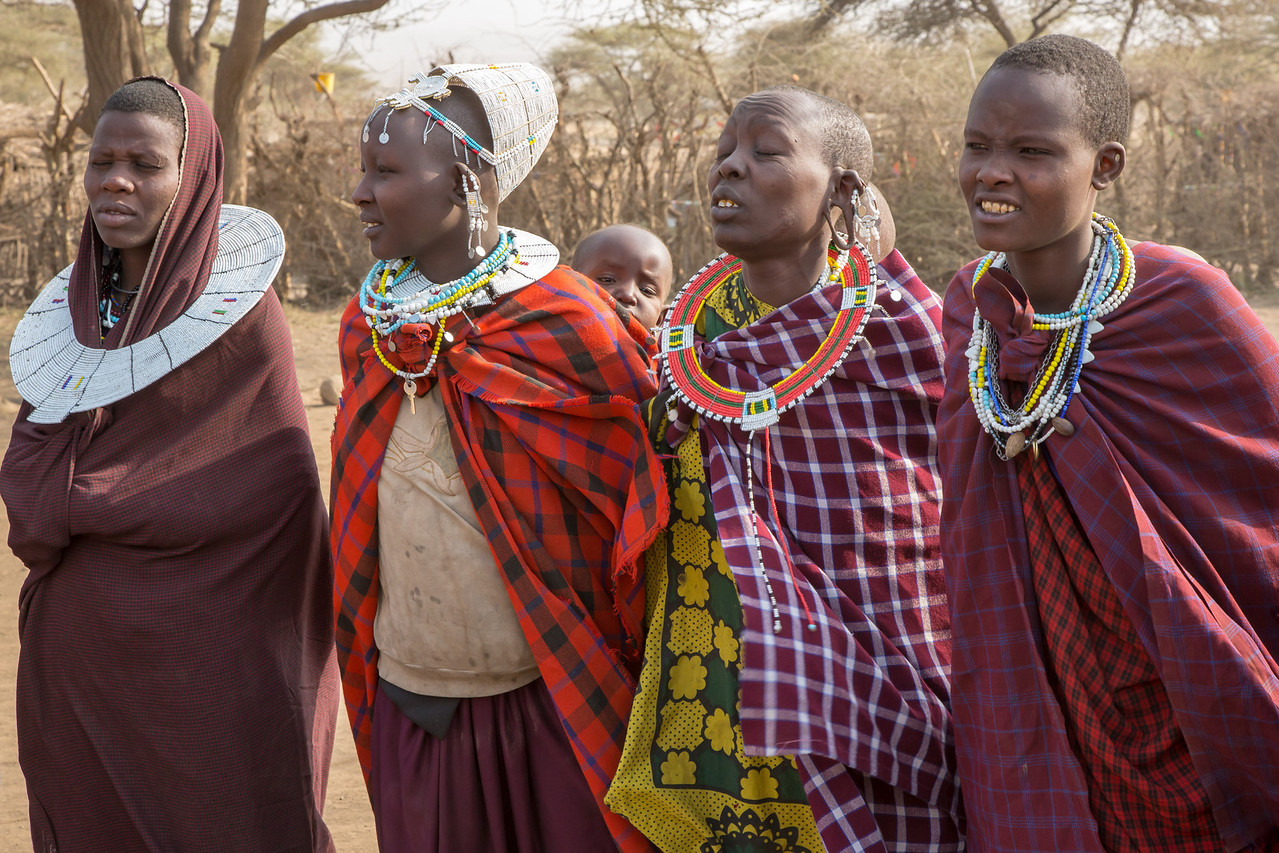 Women are responsible for chores such as cooking and milking the cows while the men tend to the cattle.