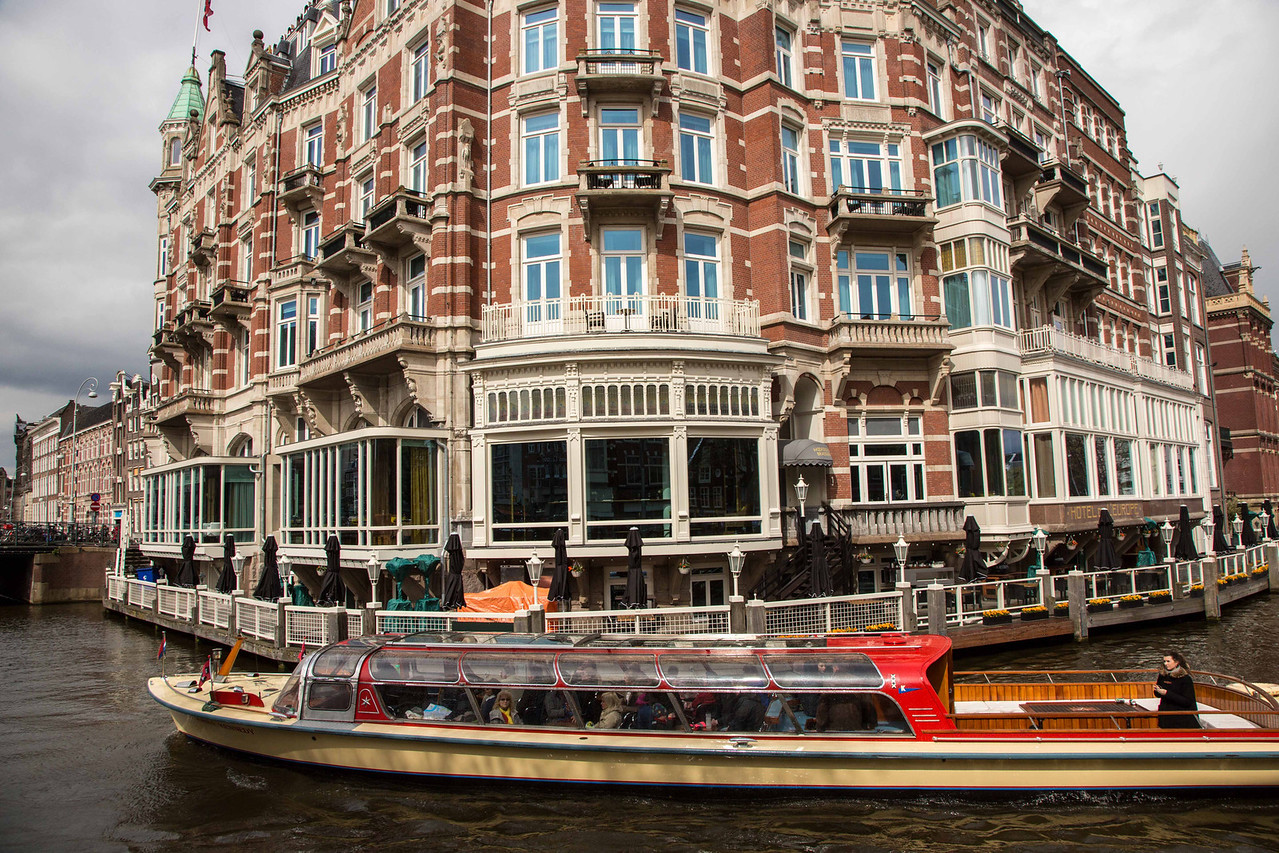 If you visit Amsterdam you'll want to take a tour boat of the canals similar to the one shown here.
