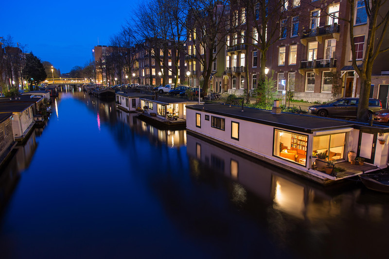 Peeking into a houseboat at dusk.