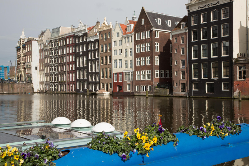 Large apartment buildings line the canals.