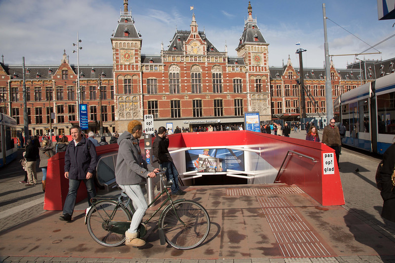 The hub of Amsterdam transportation, the train station which is serviced by a network of street cars and canals.