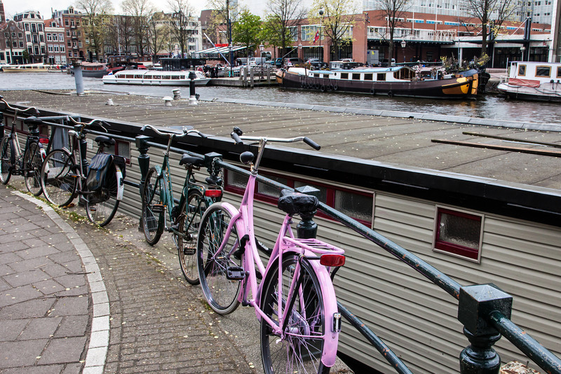 A most familiar sight in the Netherlands....bikes, canals, and houseboats.