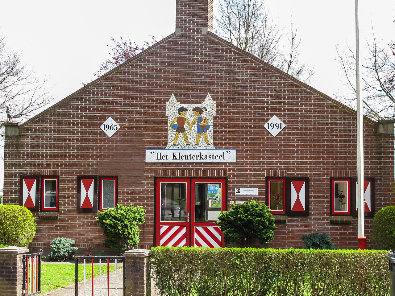 An attractive-looking elementary school in a small Dutch town.  Most all of the homes and businesses had the same type of red and white decorations.