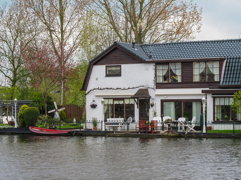 A fairly typical scene along one of the many canals and rivers in The Netherlands, although this was one of the larger homes we saw, complete with a garden and outdoor sitting area.