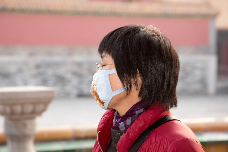 Although the pollution was not as bad in Beijing when we were there it was common to see people wearing masks as this woman was in the Forbidden City.