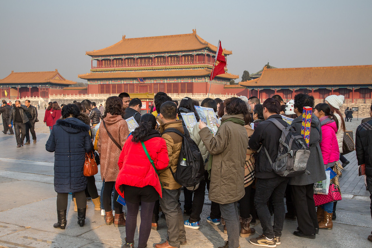 The Forbidden City is another popular attraction for Chinese citizens as well as international visitors. Here's a group of Chinese visitors receiving information about the history of the City.