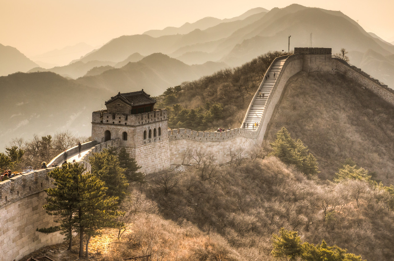 The Great Wall was begun in the 7th Century BC and extended in a east-west direction. The actual wall is over 3,000 miles long as it twists and winds over the mountainous countryside.