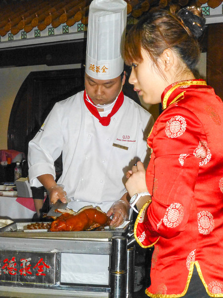 We had a unique dining experience after seeing the Forbidden City. We went to a famous Peking Duck restaurant where they brought out the whole cooked duck and carved it before us. Then we took the small slices, dipped it in a sauce, combined it with some vegetables, and placed it in a wrap similar to a soft shell fajita.
