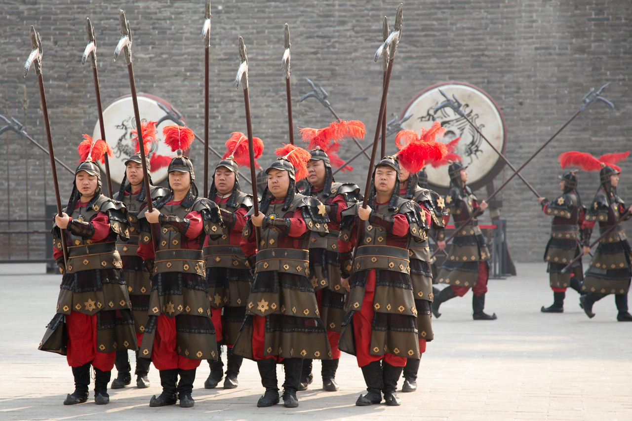 We visited the Ancient City wall in Xian and saw the changing of the guards.