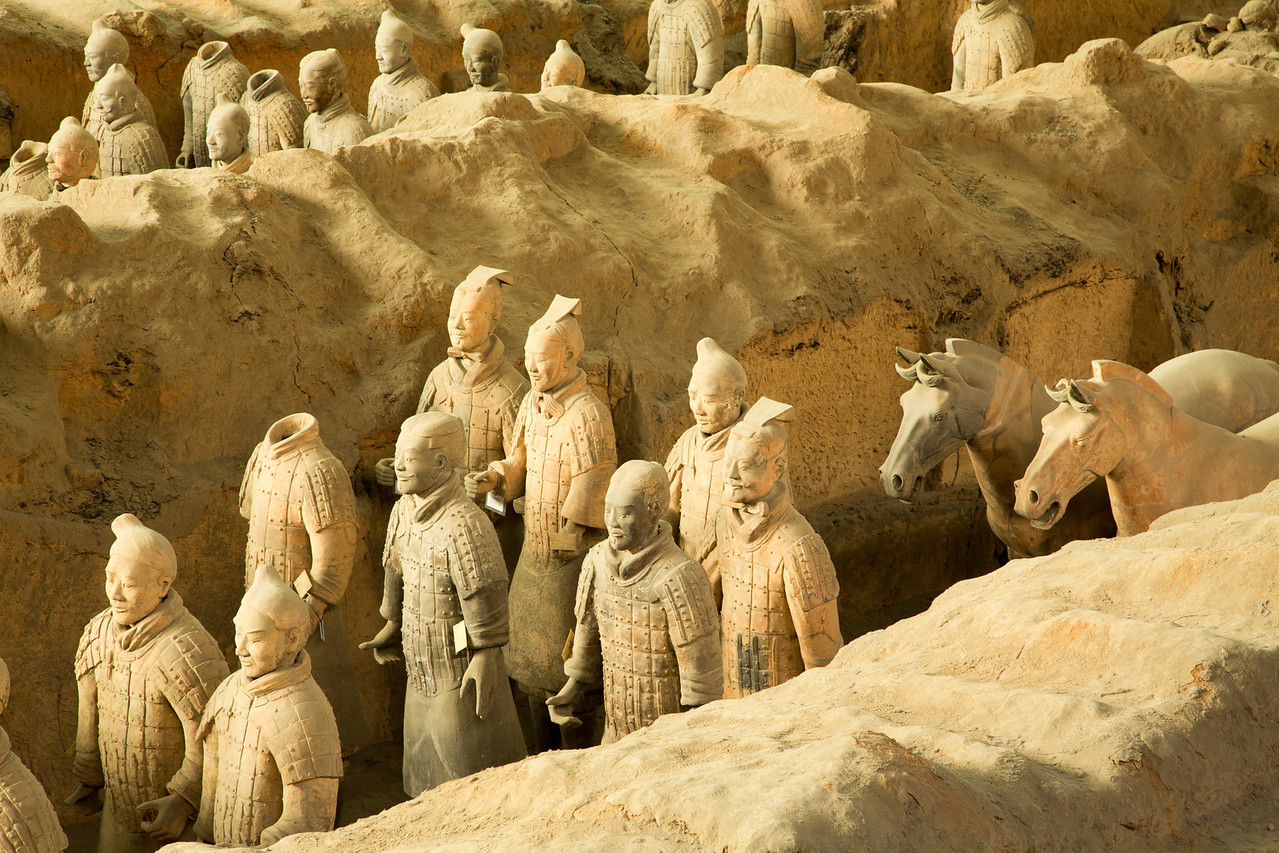 The figures include warriors, chariots, and horses.