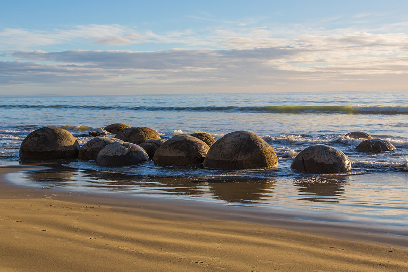 A view of the very large, spherical Moeraki Boulders just after sunise.